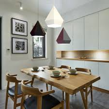 mini pendants typically serve as work lights which define the surface area of a kitchen island