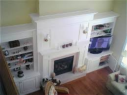 fireplace mantel wall unit and tv enclosure custom designed to suit 14 ceilings