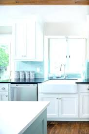 white kitchen cabinets with blue glass backsplash blue glass kitchen glass metal tile sea blue aqua