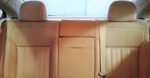 clean tan seats in the rear of a car s cabin