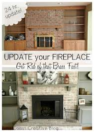fireplace makeover including painted mantel and shelves white washed brick and spray painted brass surround