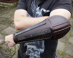 leather bracer with metal straps elbow protection for combat