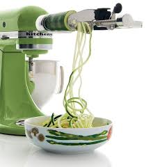 kitchenaid mixer attachments slicer. green kitchenaid artisan mixer with a spiralizer attachment, making zucchini noodles. attachments slicer