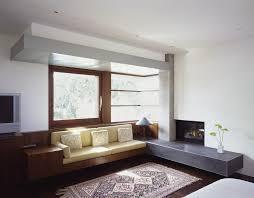 define hearth with modern living room also asian bench built in sofa frank lloyd wright hearth mid century modern minimal oriental rug raised hearth