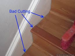 bad laminate stair installation it shows gaps where the treads and risers were cut