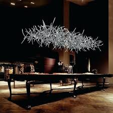 each antler is made of hand welded steel fitted with a small glass crystal modern lights