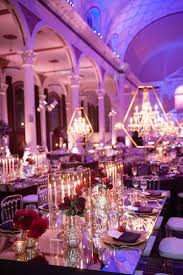 vibiana wedding reception with mirror table taper candles in lucite box and purple lighting table i18 table