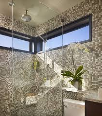view in gallery brilliant glass shower door gives this bath an airy feel despite small space on offer