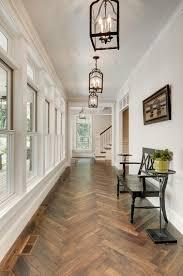 Herringbone wood floor -- Divine Custom Homes foyer via Houzz.com. Flooring  options
