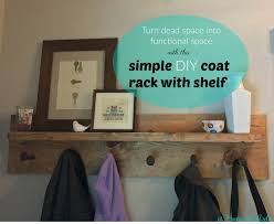 Shelf And Coat Rack Simple DIY coat rack with shelf and railroad spikes tutorial at 87