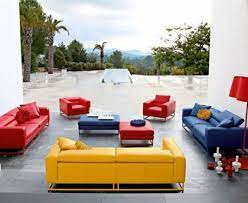 the red couch and chairs blue couch