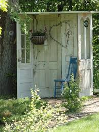 a lovely garden shed made with 5 recycled doors you say romantic
