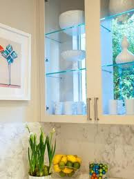 Stationary window design with kitchen cabinets and glass shelves