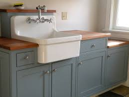 farmhouse utility sink laundry room traditional with beaded cherry counter custom image by hot apple pine llc