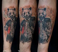 значение тату панда для девушек и мужчин на руке