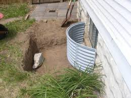 one of the window wells that we installed at the back of the house