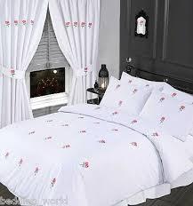 super king size bed fl white duvet