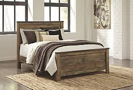 Boys storage bed Space Underneath Large Trinell Queen Panel Bed Brown Rollover Ananthaheritage Kids Beds Dream Comfortably Ashley Furniture Homestore