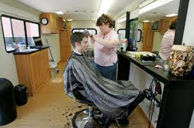 google office amenities. a google employee gets free haircut on site office amenities o