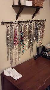 Jewelry wall DIY- this looks like shower hooks on a curtain rod but how  easy!