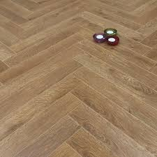 ... Prestige Herringbone Natural Oak 8mm Laminate Floor