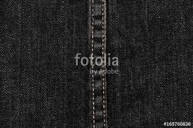 Close Up Of Black Denim And Stitches Jeans Texture For Graphic