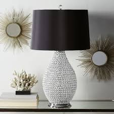 countless crystal beads are individually strung to create this lampu0027s stunning vase allowing you bead lamp i48