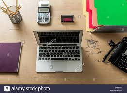 home office technology. A Modern Work Space Home Office With Laptop, Calculator, Phone, Pencils And Other Objects From Above Technology I