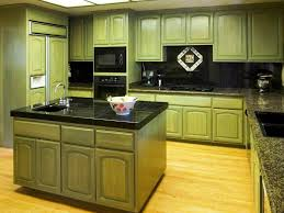 green cabinets with black countertops