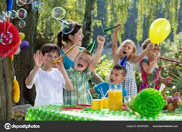 kids birthday hats playing balloon garden party stock photo