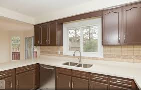 spray paint kitchen cabinets cost beautiful cabinet refinishing spray painting and kitchen cabinet painting in