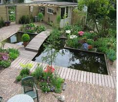 Beautiful Garden Design With Pond With Full Of Green And Flowers Delectable Pond Garden Design