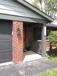 exterior paint colors that go with brickred orange brick with charcoal mansard roof and charcoal trim