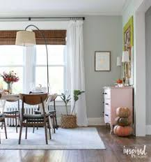 i like this bright diing room with mid century modern chairs and a painted dresser beautiful dining