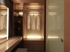wardrobe lighting ideas. Interior: Minimalist White Closet Ideas With Extraordinary Led Lighting Decoration Plus Incredible Glass Shelf Design - Stunning Tips Wardrobe D