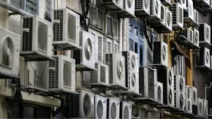 air conditioning. rows of air conditioners are seen on the walls a building in singapore\u0027s financial district conditioning