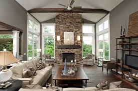 gorgeous monte carlo ceiling fans in living room contemporary with taupe paint next to freestanding fireplace alongside fireplace mantel