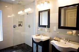 affordable bathroom vanities with modern design featuring frosted glass double door cabinet and astounding white basin under fascinating brown wooden affordable contemporary vanity lights