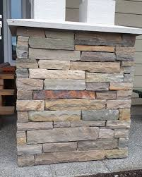 stone veneer on pillars using copper canyon ledgestone supplied by brock white on a residential property in mill bay