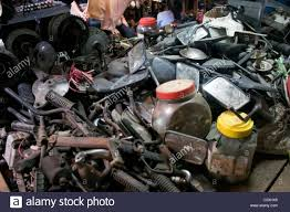 used motorcycle parts are for sale at a second hand shop at the