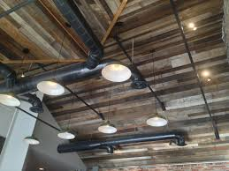 exposed ceiling lighting. Photo Of Hub Coffee Roasters - Reno, NV, United States. Reclaimed Wood Ceiling Exposed Lighting
