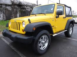 sold 2009 jeep wrangler x 4x4 2 door soft top yellow 3 6 25k at ford of murfreesboro 888 439 1265 you