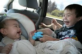 kids playing in car