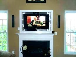 tv stand over fireplace