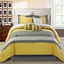 grey stained wooden bed with yellow and grey duvet cover and sham also cushion as well as gray and yellow chevron comforter plus yellow and gray comforters