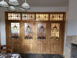stunning stained glass bifold srt with transom frame