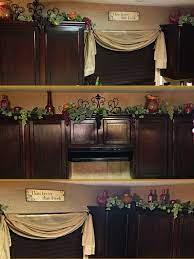 Decor On Top On Kitchen Cabinets Grapes Vines And Porcelain Pots Wine Decor Kitchen Grape Kitchen Decor Tuscan Decorating Kitchen