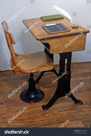 antique school desk and chair on old wooden planking floor with book chalk board