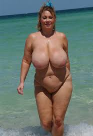 Mature big breast on beach