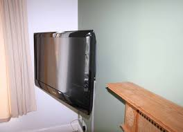 tv wall mounted in on vogels arm bracket